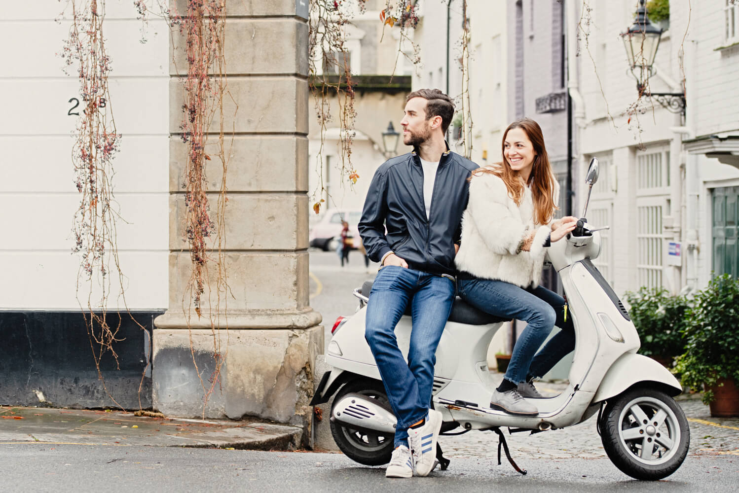 couples portrait on a vespa scooter